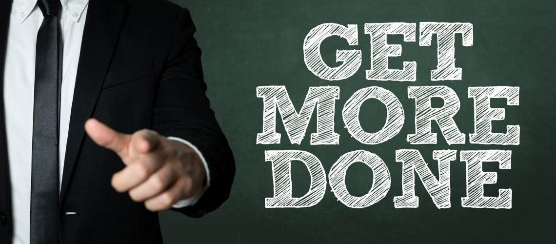 Business man pointing with the text: Get More Done