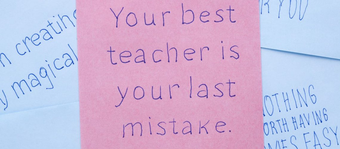 Sticky note with text your best teacher is your last mistake.